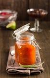 Glass jar of apricot jam Stock Photo