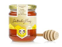 A glass jar of Austrian Suedtiroler Honey Royalty Free Stock Photography