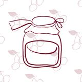 Glass jar on the background of cherries� Royalty Free Stock Photography