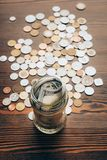 Glass jar with banknotes and coins Royalty Free Stock Image