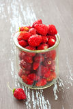 Glass jar with berries Royalty Free Stock Image