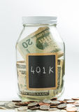 Glass Jar with chalk panel used for 401K retirement Stock Photos