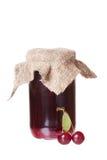 Glass jar with cherry jam Stock Photos