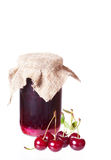 Glass jar with cherry jam Royalty Free Stock Images