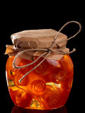 Glass jar with citrus zest preserves Stock Image