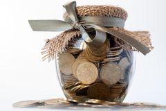 Glass jar with coins Stock Image