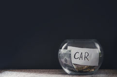 Glass jar with coins for car Stock Photography