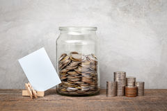 Glass jar with coins. Stock Images