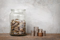 Glass jar with coins. Stock Photography