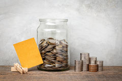 Glass jar with coins. Royalty Free Stock Photos