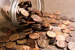 Glass jar with coins on table. Money saving concept royalty free stock image