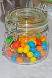 Multicolored candies in a glass jar. In a glass jar of colorful candy Royalty Free Stock Images