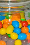 In a glass jar of colorful candy. Multicolored candies in a glass jar Stock Image