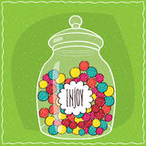 Glass jar with colorful round candies inside Royalty Free Stock Photography