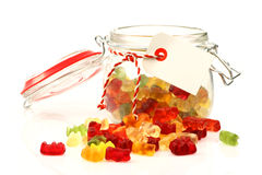 Glass jar with colorful sweets Royalty Free Stock Photography