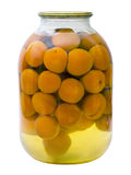 Glass jar with a compote of canned apricots Stock Photography