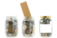 A glass jar contains saving money Stock Image