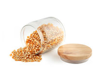 Glass jar with corn grain. On white background Royalty Free Stock Photo