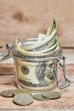 Glass jar with dollar bills Royalty Free Stock Photo