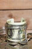 Glass jar with dollar bills Royalty Free Stock Photos