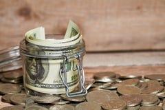 Glass jar with dollar bills Stock Photos