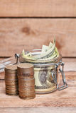 Glass jar with dollar bills Stock Photo