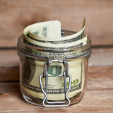 Glass jar with dollar bills Royalty Free Stock Photography