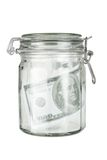 Glass Jar with Dollar Note Stock Photography