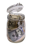 Glass jar with dollars Royalty Free Stock Images