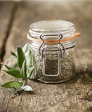 Glass jar with dried herbs Royalty Free Stock Photo