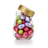 Glass jar with Easter eggs Royalty Free Stock Photography