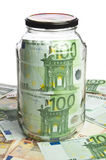 Glass jar and euro banknotes Stock Image