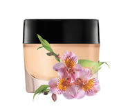 Glass jar of face cream and lilly flower isolated on white Royalty Free Stock Photography