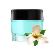 Glass jar of face cream and white lilly flower isolated on white Royalty Free Stock Image