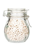 Glass jar filled with beans Stock Photography