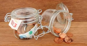 Glass Jar Filled With Cash Stock Images