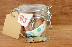 Glass Jar Filled With Cash royalty free stock photography