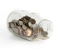 Glass Jar filled with coins Stock Photography