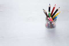 Glass jar filled with colored pencil crayons Royalty Free Stock Images