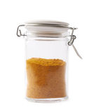 Glass jar filled with curry powder Royalty Free Stock Image
