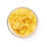 Glass jar filled with dry farfalle pasta over isolated white background Royalty Free Stock Photography