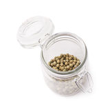 Glass jar filled with green peppercorn Stock Photo