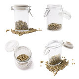 Glass jar filled with green peppercorn Royalty Free Stock Image