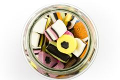 Glass jar filled with liquorice candy Royalty Free Stock Photos