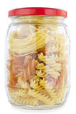 Glass jar is filled by macaroni and paste Stock Photography