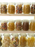 Glass jar filled with pasta Stock Images