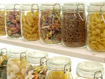 Glass jar filled with pasta Royalty Free Stock Image
