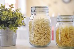 Glass jar filled with pasta Royalty Free Stock Photo