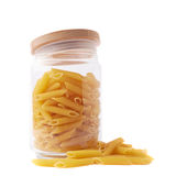 Glass jar filled with penne pasta isolated Royalty Free Stock Image