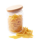 Glass jar filled with penne pasta isolated Stock Photo